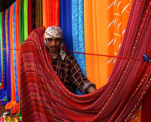 A man selling finished textiles.